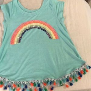 A turquoise rhinestone shirt